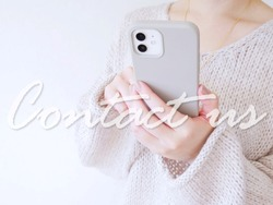 Image of a woman with a smartphone inquiring