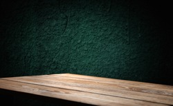 image of a wooden table on an abstract dark background with light in the center