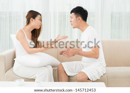 Image of a young couple having argument at home
