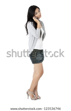 Image of a young female talking on mobile phone