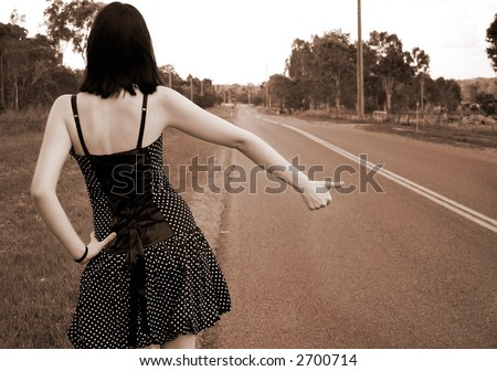 Image of a young girl hitch hiking.