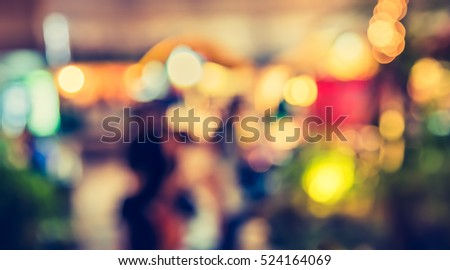 Image of Abstract Blur Food Stall at street night market with bokeh for background usage .(vintage tone)