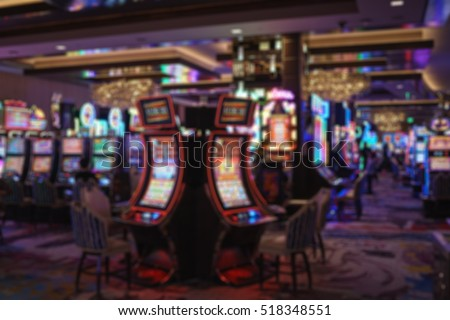 Image of abstract blur slot machine in Las Vegas casino for background usage