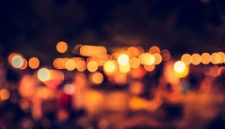 image of Abstract blurred night  bokeh background with warm  light . (vintage tone)