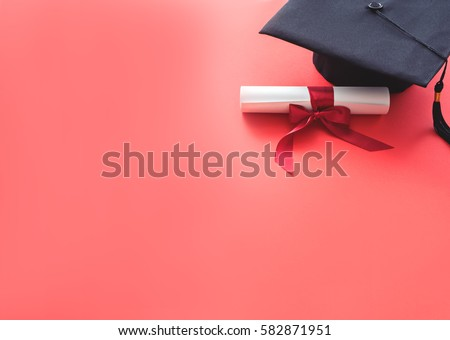 image of academic hat with diploma at red background. graduation theme