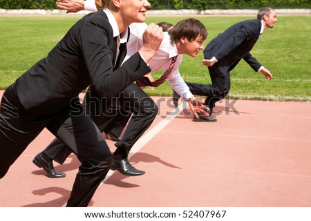Image of active employees running on sport track