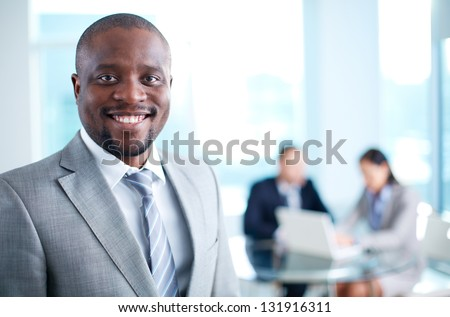 Image of African-American business leader looking at camera in working environment #131916311
