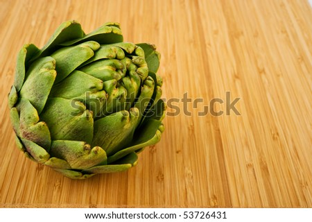 Image of an artichoke on cutting board