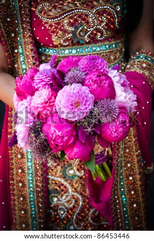 Image of an Indian brides hands holding bouquet - stock photo