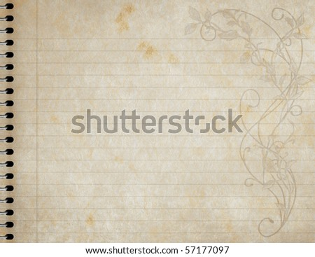 image of an old  book of lined paper with floral design