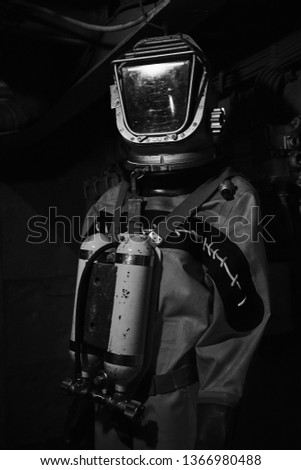 Image of an old diving suit. #1366980488