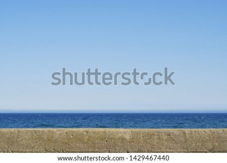 Image of an old embankment and the sea and sky ストックフォト ©