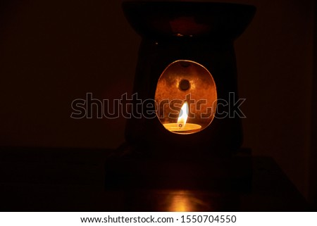 Image of an old lantern with illuminated candle light #1550704550