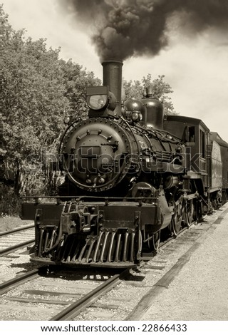 Image of an old locomotive done in sepia. Scanned film.
