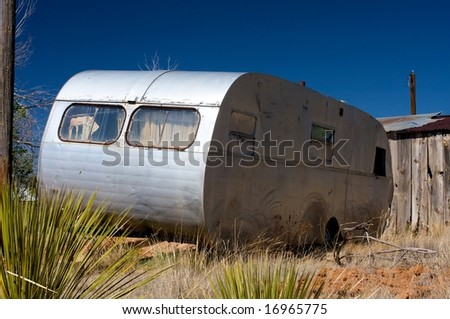 Image of an old trailer and broken down shack