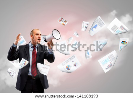 Image of angry businessman screaming in megaphone