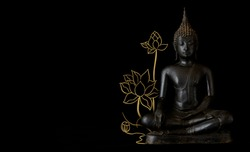 Image of antique bronze metal buddha statue with golden lotus drawing line art on right hand with black copy space. The holy sitting sculpture show peaceful and relaxation of meditating.