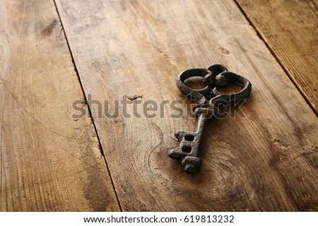 Image of antique key on old wooden table. - Shutterstock ID 619813232