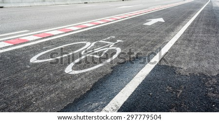 image of asphalt road and new bike lane with sign for background usage. #297779504