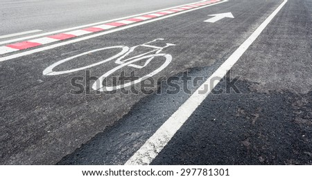 image of asphalt road and new bike lane with sign for background usage. #297781301