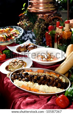 Image of assorted gourmet entrees on display table