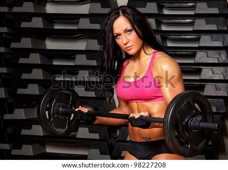Image of athletic woman doing exercise in gym