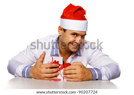 Image of attractive male with christmas presents, isolated on white