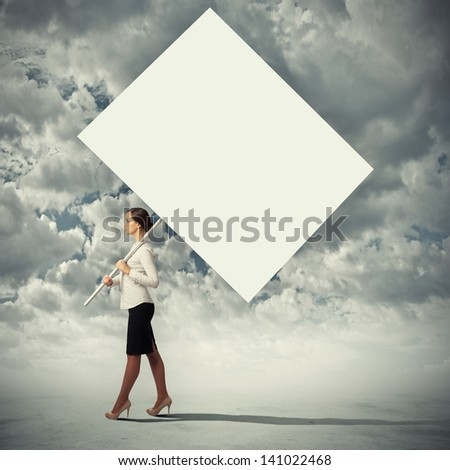 Image of attractive woman holding blank board. Place for text