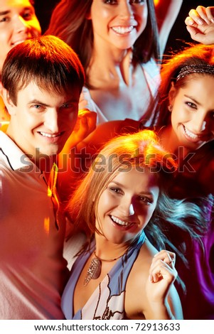 Image of attractive young people having fun at disco