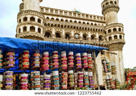 Image of bangles for sale at a retail store in the markets with the landmark Char Minar in the backdrop of Hyderabad,Telangana, India #1223755462