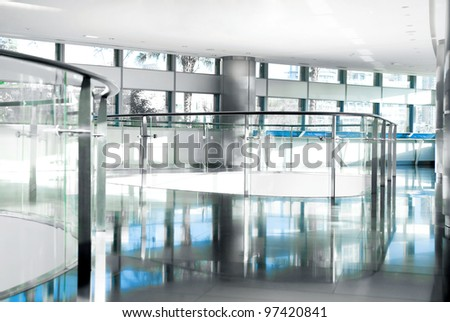 Image of banisters and windows in office building