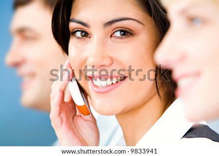 Image of beautiful business woman calling by mobile
