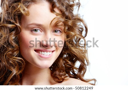 Image of beautiful young woman with curly hairs looking at camera