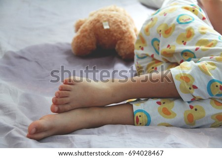 Shutterstock Image of Bed-wetting situation in 4 or 5 years old girl.Girl wet the bed while she was sleeping.Selective focus
