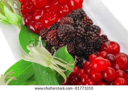 image of blackberry, cherry and cranberry on white