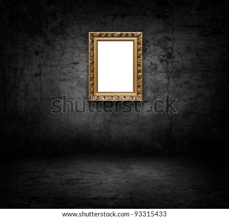 Image of blank art frame on concrete wall