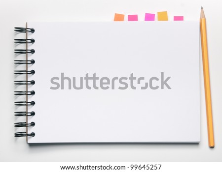 Image of blank notebook with bookmarks and pencil