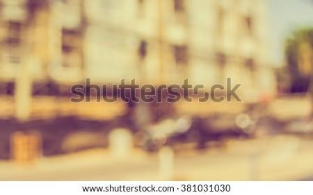 image of blur building construction site for background usage. (vintage tone) #381031030