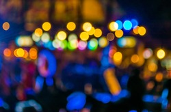 image of blurred bokeh background with warm colorful lights.