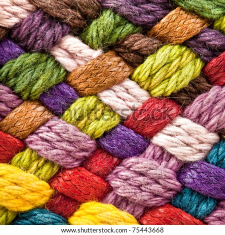 image of braided multi colored woollen yarns
