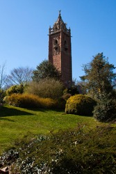 Image of Brandon Hill, a city park with wild flowers, trees and shrubs located near Bristol city center. At summit there is Cabot tower which was built to commemorate John Cabot's voyage to new world.