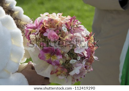 Image of bridal bouquet in bridals hands