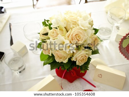 Image of bridal bouquet on the table - stock photo