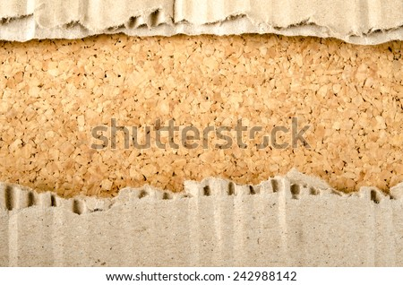 Image of brown Corrugated paper ripped on cork background