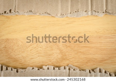 Image of brown Corrugated paper ripped on wood background