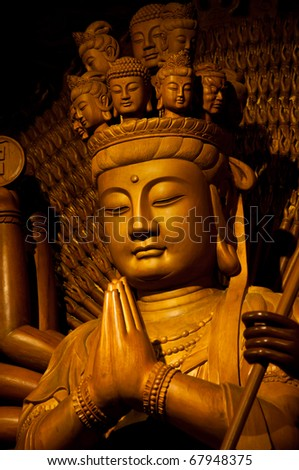 image of buddha make of Wood carving chinese art in thailand
