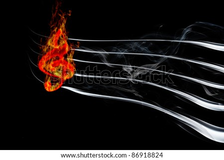 Image of burning music on a black background