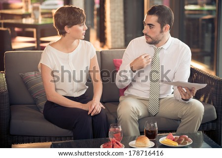 Image of business colleagues where a man expressing his point of view while business discussion