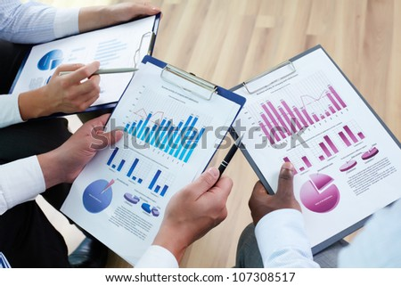 Image of business documents in human hands during discussion - stock photo