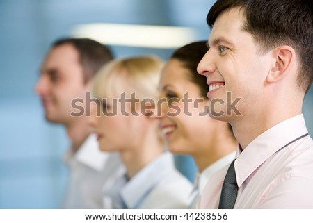 Image of business group standing in line with handsome leader in front